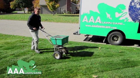 AAA fertilizing the lawn